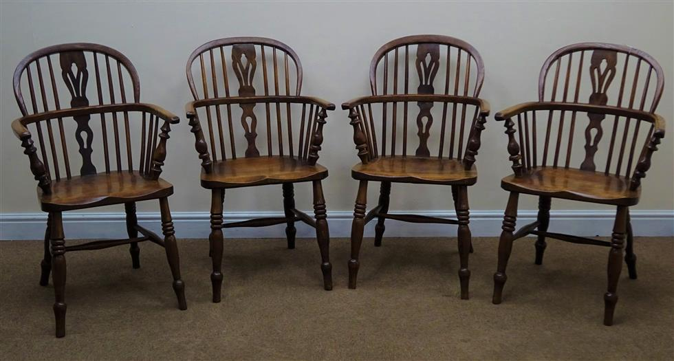 Four 19th century ash and elm low back Windsor armchairs