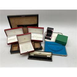 Collection of jewellery boxes including a vintage Boodle & Dunthorne bracelet box, two modern Boodles boxes, two Cartier Santos 701 sunglasses cases, one other Cartier box, Harrods cufflink/ring box and a Penlington & Batty necklace box (8)