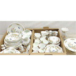 A large quantity of Aynsley Cottage Garden dinner and tea wares, to include dinner plates, dessert plates, side plates, bowls, serving dish, serving dish and cover, ramekins, cruets, mugs, large jug, pair of candle sticks, various vases, pin dishes, etc.