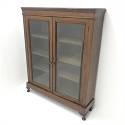Victorian walnut bookcase, two glazed doors enclosing three adjustable shelves, cabriole feet, W107cm, H132cm, D28cm