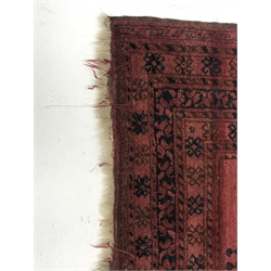 Afghan red ground rug, field decorated with Guls, repeating border, 204cm x 112cm
