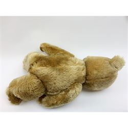 Chiltern Hugmee large teddy bear c1950s with kapok filled long-plush body, jointed swivel head with original orange and black glass eyes and vertically stitched nose and mouth, jointed limbs with card lined feet and velvet covered pads and inoperative squeaker H22