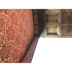 17th century and later Jacobean style oak four poster bed with canopy, the projecting canted cornice above patterned fabric frieze supported by two turned posts, the back with geometric guillouche carved frieze and three deeply recessed panels with egg and dart and other decorative mouldings, W155cm, H217cm, L220cm