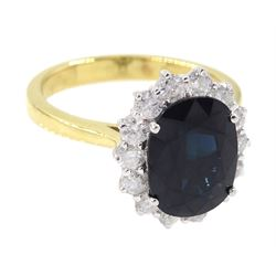 18ct gold oval sapphire and round brilliant cut diamond cluster ring, hallmarked, sapphire approx 3.30 carat, total diamond weight approx 0.70 carat