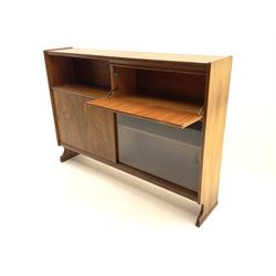 Nathan teak side cabinet, fitted with fall front cupboard, above two sliding doors one glazed, raised on stile supports