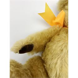 Chad Valley Hygienic Toys teddy bear c1950, kapok filled mohair plush body with original factory given yellow neck ribbon, jointed limbs with velvet paw pads, glass eyes and vertically stitched nose and mouth, blue/white printed label to side seam H12