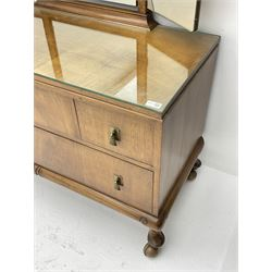 Waring and Gillow - early to mid 20th century figured walnut dressing chest, triple shaped mirror back, fitted with four drawers, cabriole supports with castors, labelled