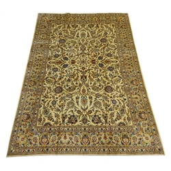 Persian Kashan rug carpet, ivory ground decorated with interlacing scrolled foliage and stylised flower heads, seven band border with repeating pattern, 402cm x 282cm