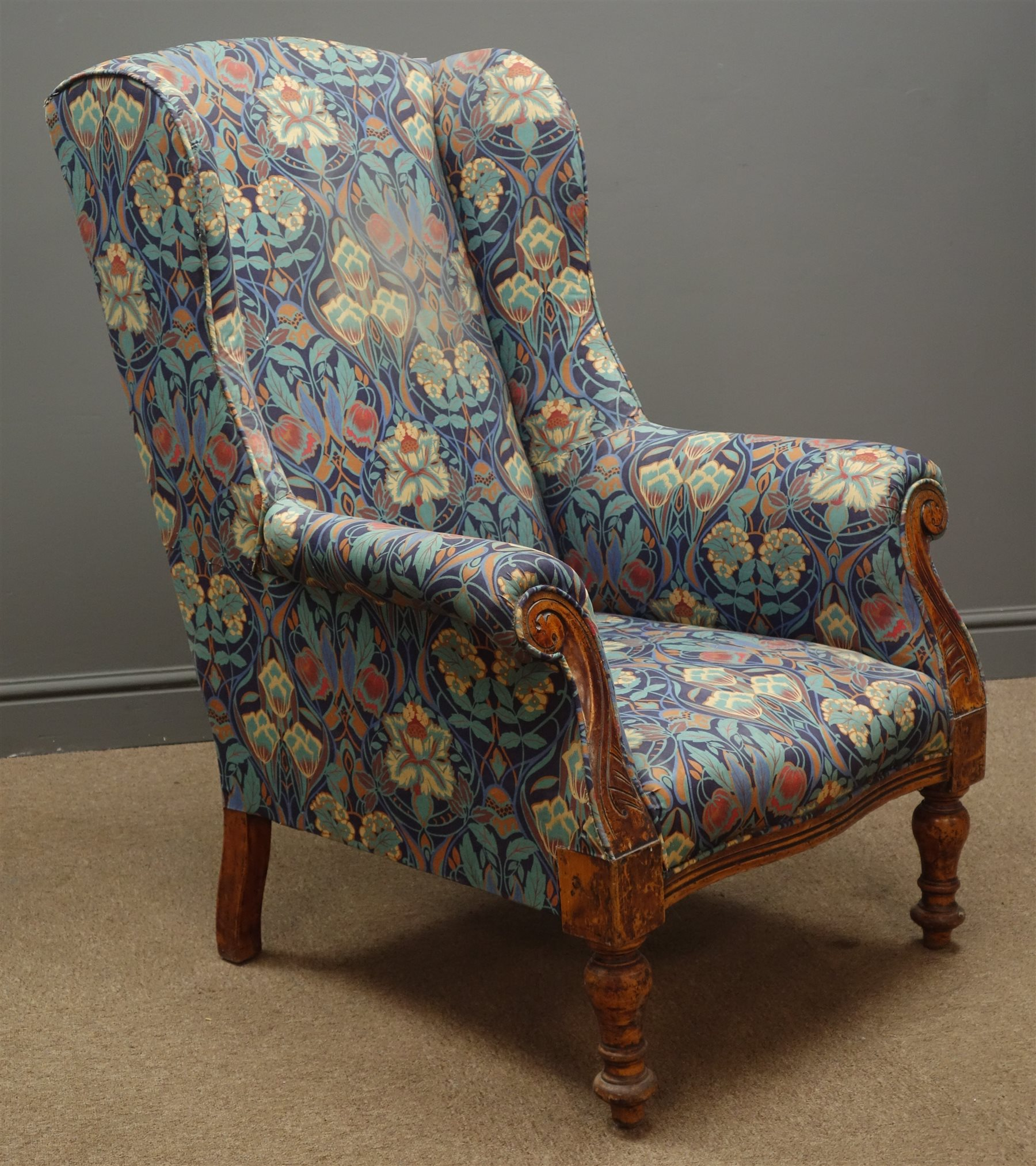 Victorian Wingback Armchair Upholstered In Floral Pattern Fabric Scrolled Arms And Turned Supports Antiques Interiors