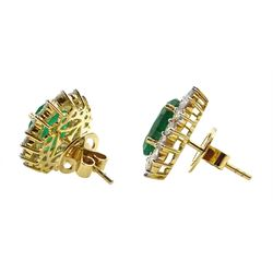 Pair of 18ct gold oval emerald and round brilliant cut diamond cluster stud earrings, stamped 750, total emerald weight approx 5.80 carat, total diamond weight approx 2.00 carat