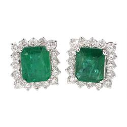 Pair of 18ct white gold emerald and round brilliant cut diamond cluster stud earrings, stamped 18K, total emerald weight approx 3.80 carat, total diamond weight approx 1.40 carat