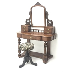 Victorian mahogany Duchess dressing table, arched bevelled swing mirror above four small drawers, shaped moulded top above single drawers, turned and carved supports on undertier, with Victorian revolving stool, W106cm, H147cm, D45cm