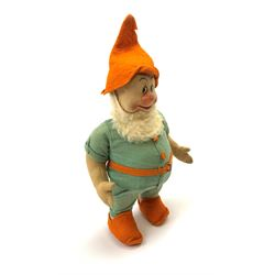 Chad Valley pressed felt figure of the Disney Snow White dwarf 'Doc' with painted facial features, standing wearing a green linen suit with orange hat, belt, buttons and shoes H13