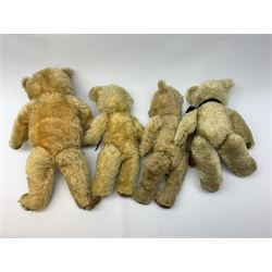 Four English teddy bears 1930s-50s comprising Chiltern with revolving head, plastic eyes and plastic dog type nose, jointed limbs with velvet paw pads and back aperture for key-wind musical movement H17