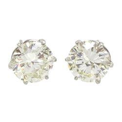 Pair of platinum round brilliant cut diamond stud earrings, Birmingham 1981, total diamond weight 5.00 carat, VS1-VS2 clarity, colour K, with World Gemological Institute certificate