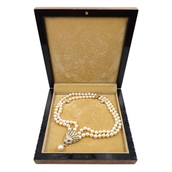 Akoya pearl and diamond lion's head necklace, double strand cultured pearls of approx 8mm, decorated centrally with an 18ct gold pave set diamond lion's head, with emerald eyes and 13mm pearl pendant