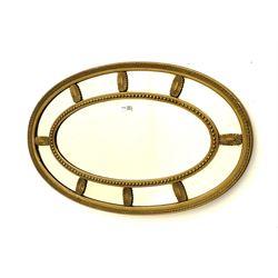 Adam's style oval gilt framed wall mirror
