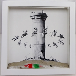 Banksy (British 1973-): The Walled Off Hotel box set print, 2017, with concrete relief element resembling the West Bank barrier, in the original artist designated Ikea frame, 25.5cm x 25.5cm, accompanied by purchase receipt from the Walled Off Hotel in Bethlehem, soap bar, welcome letter & guest information etc