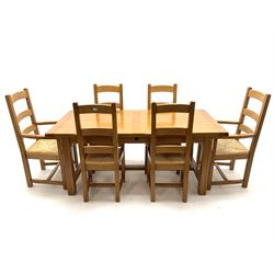 Light oak rectangular dining table with two leaves, square supports joined by floor stretcher (W280cm, H77cm, D90cm) and set six (4+2) ladder back chairs, rush seat (W60cm)