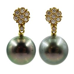 Pair of 18ct gold diamond flower head cluster stud earrings, with detachable Tahitian black pearl pendants, stamped 750, total diamond weight approx 0.45 carat