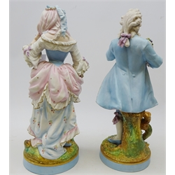 Pair of large 19th century Meissen bisque porcelain figures depicting a young lady and gentleman in 18th century dress, impressed to base A.M and painted crossed swords mark, H47cm