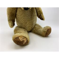 Very large Irish Tara bear c1950s with plush covered body, swivel jointed head with glass eyes and vertically stitched nose and mouth, jointed limbs with rexine pads and growler mechanism H37