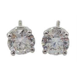 Pair of 18ct white gold single stone round brilliant cut diamond stud earrings, total diamond weight 1.97 carat, with certificate