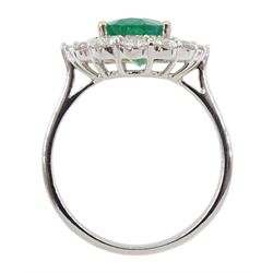 18ct white gold emerald and diamond cluster ring, the central oval emerald with baguette, tapered baguette and round brilliant cut diamonds, stamped 750, emerald 2.46 carat, with World Gemological Institute Report