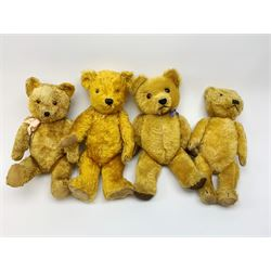 Four teddy bears 1930s - 1950s comprising Chiltern type with gold plush body, revolving head with clear glass eyes and vertically stitched nose and mouth, jointed limbs with velvet pads and card lined feet H18.5