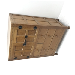 'Mouseman' panelled oak tallboy, panels and frame adzed, double cupboard above two short and two long drawers, by Robert Thompson of Kilburn, W85cm, H124cm, D49cm