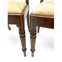 Set of fourteen Regency mahogany dining chairs, twelve side chairs with rope twist back rails above inlaid X rail, drop in upholstered seats, on turned legs, two matching carvers with hairy claw feet detail to lower arm