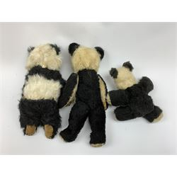 Two 1930s Chiltern panda bears, one with swivel jointed head, glass eyes, vertically stitched nose and mouth and jointed limbs H14