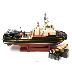 24-Volt radio controlled model of the American tug boat 'Jo-Jo' with full range of deck fittings, two batteries, transmitter, remote control, receivers and two launching straps, displayed on wooden stand L103cm
