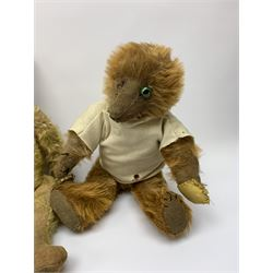 Early 20th century cinnamon coloured bear c1920, possibly continental, with unusual hedgehog styled head/face, swivel jointed head, wood wool filled body with jointed limbs, five claw stitches to feet  and inoperative growler mechanism H16