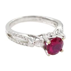 18ct white gold round ruby ring, with two marquise shaped diamonds either side and diamond set shoulders, hallmarked, ruby approx 0.85 carat