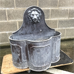 Early 20th century lead fountain, raised shaped back with moulded lions head spout, W74cm, H77cm, D40cm