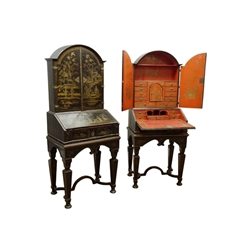 Pair 20th century Chinoiserie black lacquered side cabinets, raised backs with arched tops fitted with cupboards and drawers, above slope fall fronts with inset leather surface and fitted drawer, scrolled arched apron, square tapered supports jointed by curved stretchers, bun feet, W65cm, H157cm, D45cm