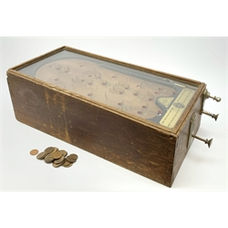 Early 20th century table top bagatelle game 'The Advance Pin Table - British Made - For Amusement Only',  in oak case with glazed top and coin operated mechanism with quantity of pre-decimal pennies 30 x 64cm