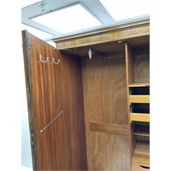 Waring and Gillow - early to mid 20th century figured walnut Gentleman's wardrobe, two doors enclosing various compartment, mirror, drawers and hanging space, labelled