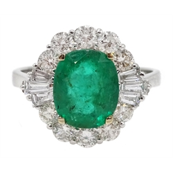 18ct white gold oval emerald, round and baguette cut diamond ring, stamped 750, emerald approx 1.90 carat