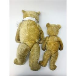 Two 1930s Chiltern type graduated teddy bears, one wood wool and one wood wool and kapok filled plush bodies, each with swivel revolving head, applied eyes and vertically stitched nose and mouth and jointed limbs, tallest H20.5