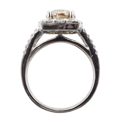 18ct white gold round brilliant cut fancy light brown diamond ring, with halo diamond surround and diamond set shoulders, stamped 750 18K, central diamond 2.00 carat, total white diamond weight 0.90ct