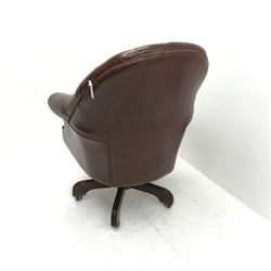 Library style swivel reclining desk chair, upholstered in deep buttoned and studded brown leather, five shaped supports, W78cm