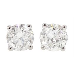 Pair of 18ct white gold round brilliant cut diamond stud earrings, stamped 750, total diamond weight approx 1.05 carat