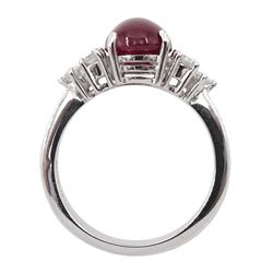 18ct white gold cabochon ruby and six brilliant cut diamond ring, hallmarked, ruby approx 3.70 carat, total diamond weight approx 0.55 carat