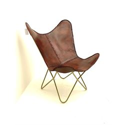 Leather sling chair over metal frame