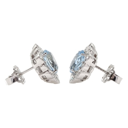 Pair of 18ct white gold oval aquamarine and diamond cluster stud earrings, hallmarked, total aquamarine weight approx 2.50 carat, total diamond weight approx 0.75 carat