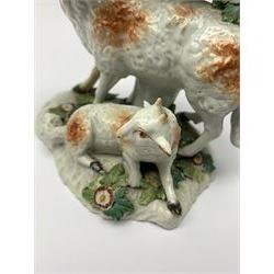 18th century Derby porcelain group, modelled as a ram standing before bocage above a recumbent lamb, upon flower encrusted base, H13.5cm, together with an 18th century Derby figure modelled as a deer, in recumbent pose before bocage, H8cm, each with patch marks beneath,