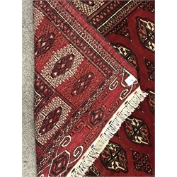 Turkman Tekke Bokhara red ground rug, the field and border decorated with guls, 177cm x 213cm