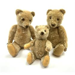 Three 1950s German teddy bears including blonde mohair, possibly Steiff, with swivel jointed head, glass eyes, vertically stitched nose and mouth and jointed limbs with felt paw pads H13